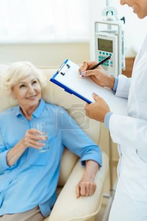 Elderly woman with doctor in hospital