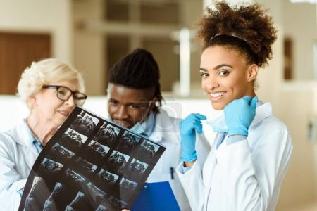 Young african american doctor with colleagues