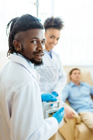 african-american doctor in hospital room