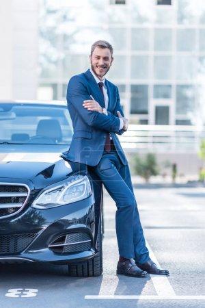 businessman at car on parking