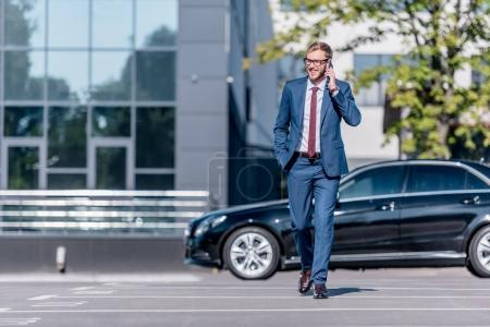 businessman in suit using smartphone