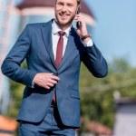 businessman in suit using smartphone