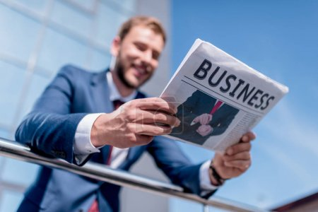 businessman with business newspaper