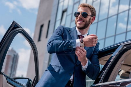 stylish businessman at car