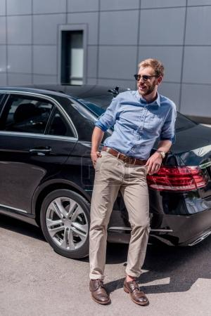 man standing at car