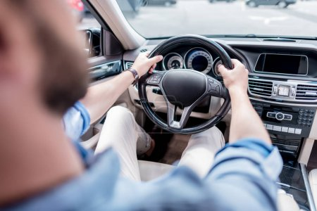 Photo for Cropped view of young man driving car - Royalty Free Image