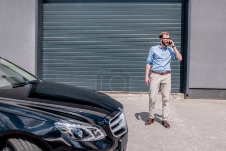 man standing near the car