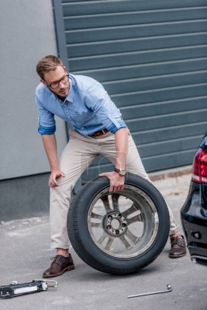 Man changing car tire