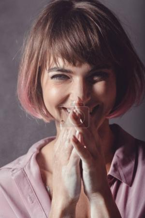 Smiling girl with pink hair
