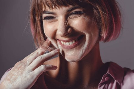 Cheerful girl with powder on face