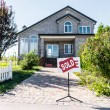 Постер, плакат: House with sign sold