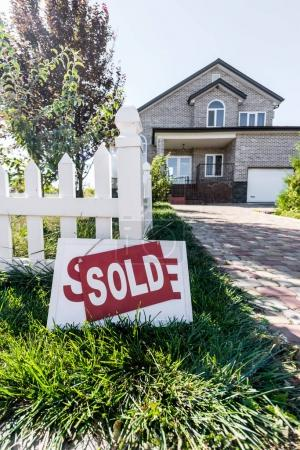 house with sign sold