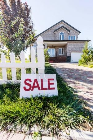 house with sign sale