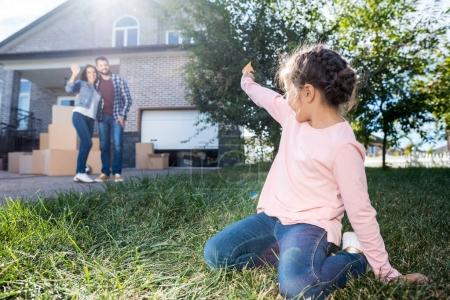 Little girl waving to parents