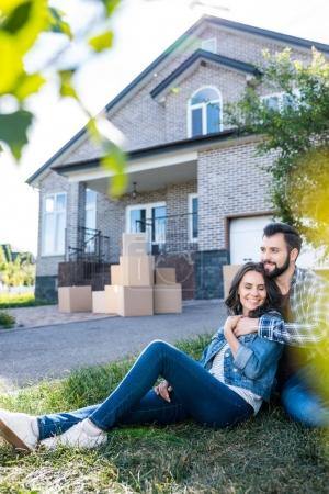 Couple relaxing on grass