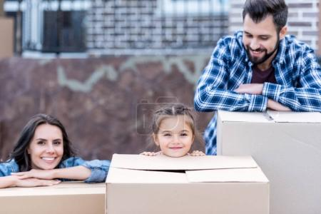 young family with boxes