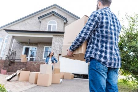 Photo for Young couple with boxes moving into new house - Royalty Free Image