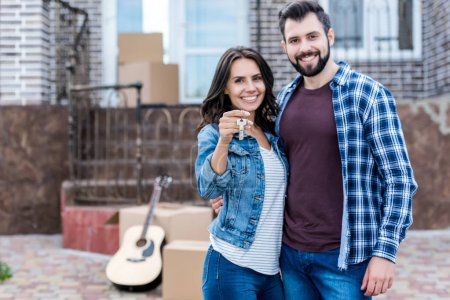 couple with keys of new house
