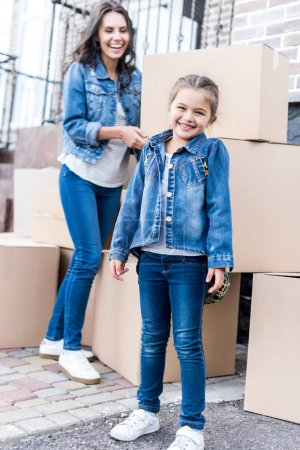 mother and daughter with cardboard boxes