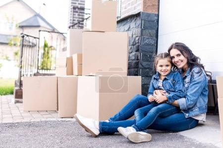 mother and daughter moving into new house