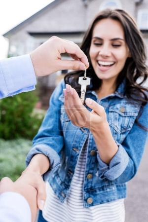 Photo for Close-up shot of woman buying new house and shaking hands with realtor - Royalty Free Image