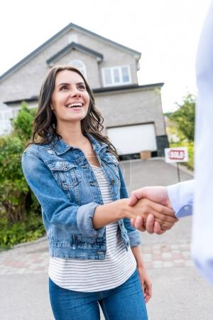 woman shaking hands with realtor