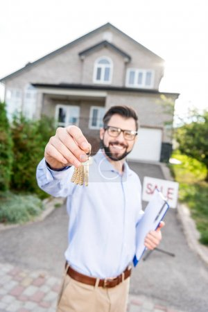 Photo for Close-up shot of realtor with keys of house - Royalty Free Image