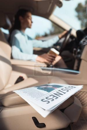 business newspaper in car