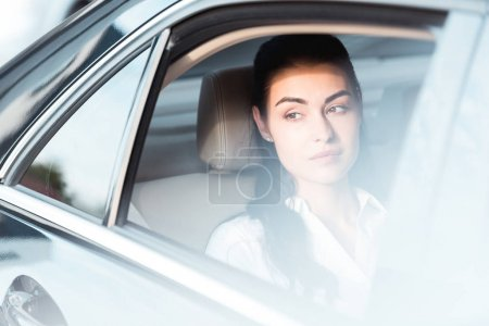 Woman in backseat of car