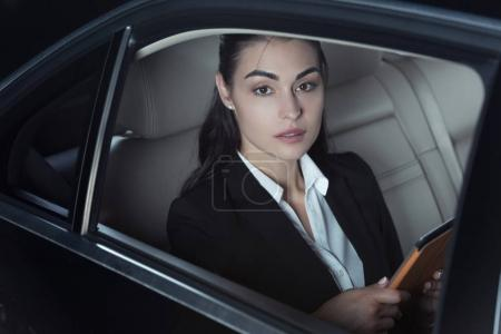 Woman in passenger seat of car