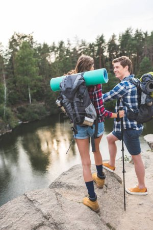 couple with backpacks having hiking trip