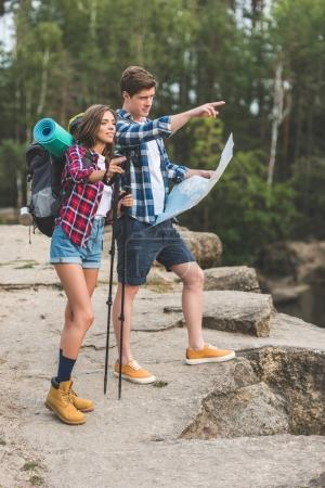Couple of hikers with map
