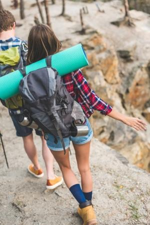 couple with backpacks hiking