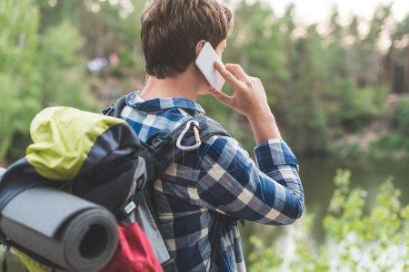 hiker talking by phone