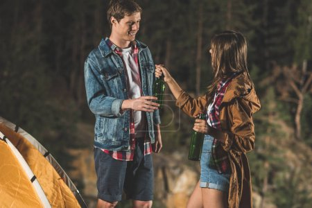 couple sharing beer in hiking trip