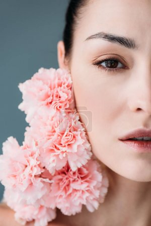 Young woman posing with pink cloves