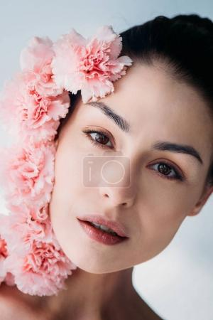 Attractive woman with bunch of pink cloves