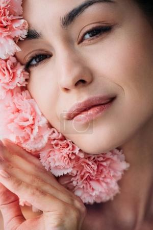 Smiling woman posing with clove flowers