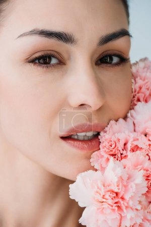 woman with fresh skin posing with flowers