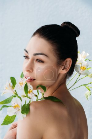 Beautiful woman with white lilies