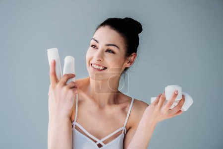 Photo for Young cheerful woman with no makeup holding various plastic bottles and jars - Royalty Free Image