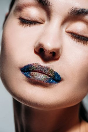young woman with glitter lips
