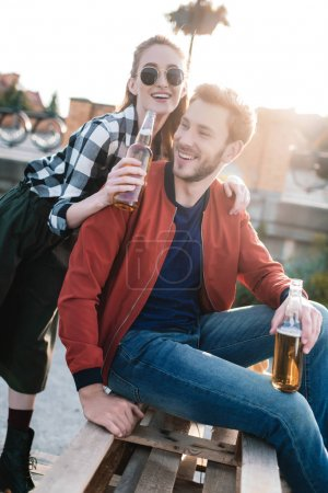 Photo for Happy couple with drinks spending time together - Royalty Free Image