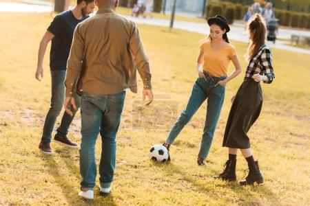 multicultural friends playing football