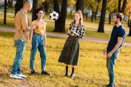 multicultural friends with soccer ball