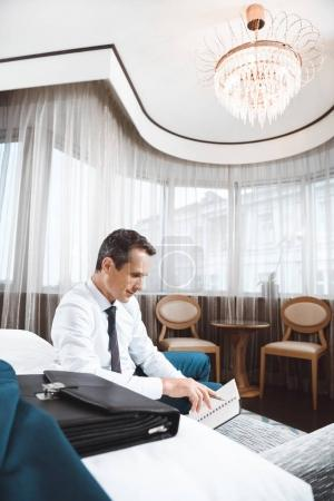 Businessman reading notebook
