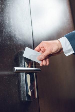 businessman opening hotel room door