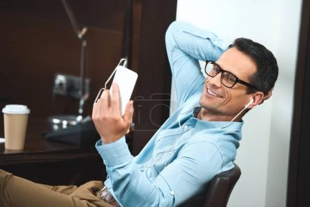 businessman reading from smartphone