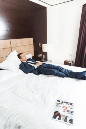 Business newspaper on hotel bed