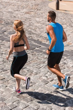 sport couple jogging in city